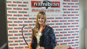Milnay posing with racket and trophy