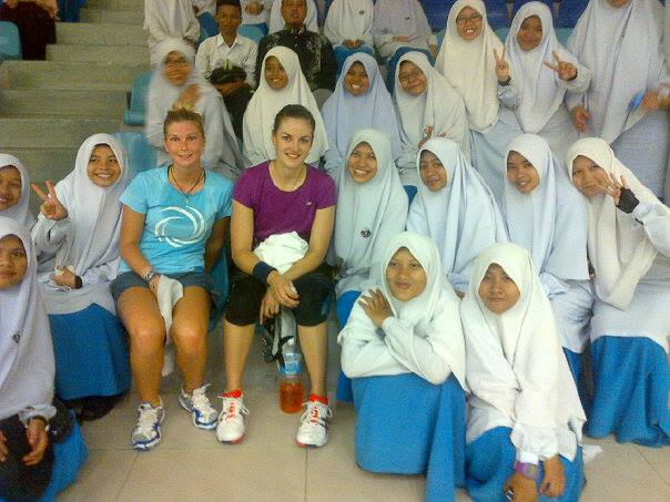 Milnay pictured with young girls in Malaysia